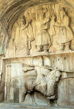 Khosrow Parviz is standing here. On his left is Ahura Mazda, on his right is Anahita, and below is, Khosrau dressed as a mounted Persian knight riding on his favourite horse, Shabdiz, in the city of, Kermanshah, Iran
