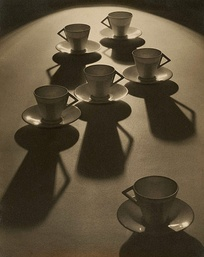 Tea cup ballet, a 1935 photograph by Olive Cotton with some inexpensive cups and saucers from Woolworths