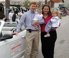 Plant City Strawberry Festival, Congressman Putnam with wife Melissa and their daughters at the Strawberry Parade in Plant City, Florida,