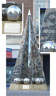 The Exeter Riddle Sculpture in Exeter High Street, created by artist Michael Fairfax and installed in 2005[145]