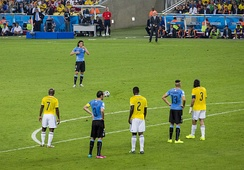 Cavani awaiting to take a free-kick in the Round of 16 game against Colombia at the 2014 World Cup