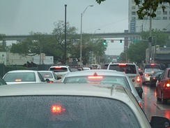 Traffic gridlock in Miami, Florida. Lights are green but backups fill all the space.