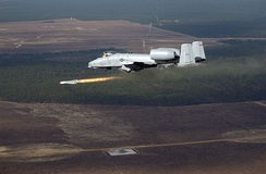 An A-10 Thunderbolt fires an AGM-65 Maverick missile over the Eglin range during a Combat Hammer Air-to-Ground Weapons System Evaluation Program (WSEP) mission, which are conducted by Eglin's 86th Fighter Weapons Squadron (FWS).