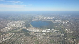 Aerial view of Sydney's western suburbs surrounding Prospect reservoir (looking west of Cumberland Plain towards Blue Mountains).