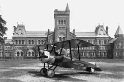 A Sopwith Camel aircraft rests on the Front Campus lawn in 1918, during World War I.