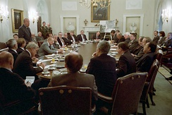 Reagan and Bush in a meeting to discuss the United States' invasion of Grenada with a group of bipartisan members of Congress in October 1983