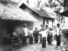 Young dancer accompanied by angklung players in Baduy, Banten. c. 1910-1930.