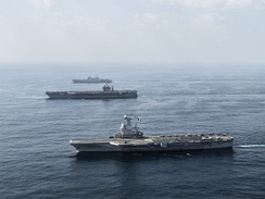 U.S. Navy, French Navy, and Italian Navy aircraft carriers conduct operations in the U.S. 5th Fleet area of responsibility in the Gulf of Oman.