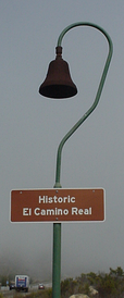 Distinctive route markers with symbolic mission bell and shepherd's crook are seen between Los Angeles and San Jose