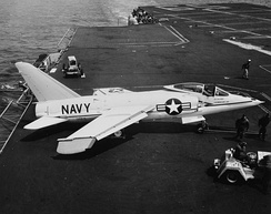 An F11F-1 Tiger on USS Forrestal (CVA-59) in April 1956, with downward-folded wingtips