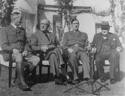 Free French Generals Henri Giraud (left) and Charles de Gaulle sit down after shaking hands in the presence of Franklin Roosevelt and Winston Churchill at the Casablanca Conference, on 14 January 1943.