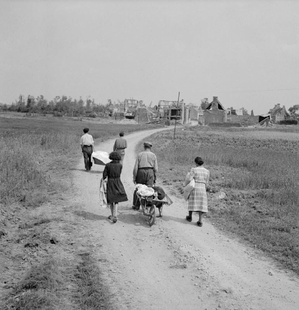 A French family returns to their village, Buron, northwest of Caen, which was completely destroyed during fighting, July 18, 1944