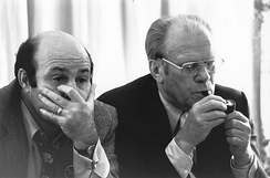 Gerald Ford (right) watching election returns with Joe Garagiola on election night in 1976. Garagiola is reacting to television reports that Ford had just lost Texas to Carter.