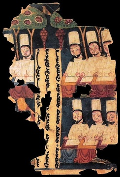 Manicheanism priests writing at their desks, with panel inscription in Sogdian. Manuscript from Khocho, Tarim Basin.