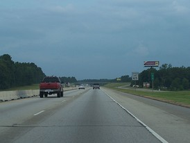 Same location as prior picture with the more recent 65 mph speed limit, photographed on August 4, 2005