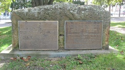 Two plaques near the Federal Land Office, located on the grounds of the reconstructed Fort Steuben.