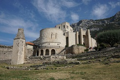 The Fortress of Krujë served as the noble residence of the Kastrioti family. Skanderbeg's long struggle to keep Albania independent became highly significant to the Albanian people as it strengthened their solidarity, made them more conscious of their national identity and served centuries later in the Albanian Renaissance as a great source of inspiration in their struggle for national unity, freedom and independence.[139][140]