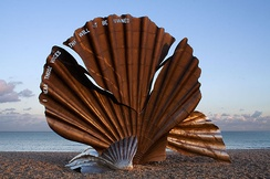 "Scallop by Maggi Hambling is a sculpture dedicated to Benjamin Britten on the beach at Aldeburgh. The edge of the shell is pierced with the words ""I hear those voices that will not be drowned"" from Peter Grimes."