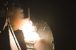 A Tomahawk cruise missile launching from USS Arleigh Burke to strike ISIL targets in Syria on 23 September