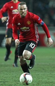 Wayne Rooney, shown wearing the number 10 shirt, was used by Alex Ferguson as a second striker on many occasions during their time together at Manchester United, playing behind the number 9.[9]