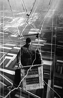 An American major, piloting an observation balloon near the front, 1918