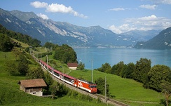 Zentralbahn Interregio train following the Lake Brienz shoreline, near Niederried in Switzerland