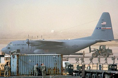 Lockheed C-130H Hercules 74-1667 of the 317th Airlift Group being unloaded despite a dust storm at Sather Air Base