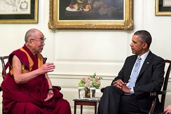 The 14th Dalai Lama meeting with U.S. President Barack Obama in 2014. Due to his widespread popularity, the Dalai Lama has become the modern international face of Tibetan Buddhism.[31]