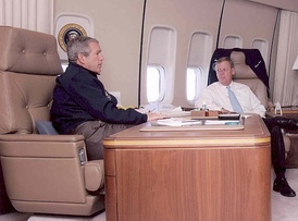 President George W. Bush and Senator Isakson aboard Air Force One in 2005.