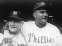 portrait shot of two men in baseball uniforms, one with an arm around the other