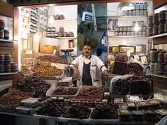 Muslims traditionally break their fasts in the month of Ramadan with dates (like those offered by this date seller in Kuwait City), as was the recorded practice (Sunnah) of Muhammad.