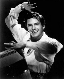 Desi Arnaz actor, musician, bandleader, comedian and film and television producer and generally credited as the innovators of the syndicated rerun