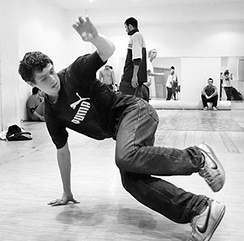A b-boy practicing downrock at a studio in Moscow.