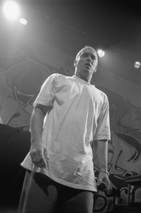 Eminem onstage in a white T-shirt