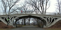 Cast-iron Gothic tracery supports a bridge by Calvert Vaux, in the Central Park from New York City
