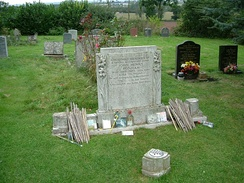 John Bonham's gravestone at Rushock Parish churchyard, Worcestershire, with drumsticks left in tribute by fans