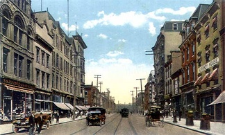 Postcard depicting Market Street in Downtown Harrisburg as it appeared in 1910. Trolley tracks are noticeable along the street.