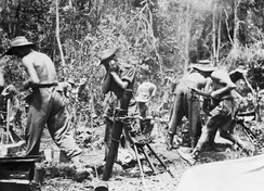British troops firing a mortar on the Mawchi road, July 1944.