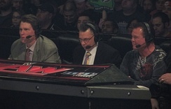 "Professional wrestling commentators John ""Bradshaw"" Layfield, Michael Cole, and Jerry ""The King"" Lawler"