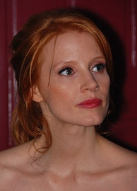 A shot of a red-haired woman as she looks away from the camera