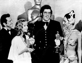 Hamlisch, at age 29, holding two of the three Oscars he won in 1974. With him are Donald O'Connor, Debbie Reynolds and Cher.