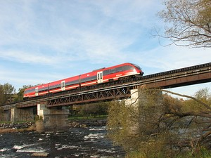 A light rail O-Train crossing the Rideau River on the Trillium Line.