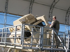 An instructor from the 99th GCTS overseeing 'HMMWV Egress Assistance Training' (HEAT) at Silver Flag Alpha RTC