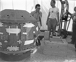 Louis Slotin and Herbert Lehr with the Gadget prior to insertion of the tamper plug (visible in front of Lehr's left knee)
