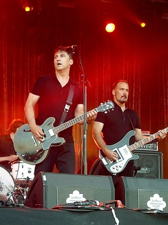 Frontman Greg Dulli (2nd from left) and bassist John Curley (right), 2012