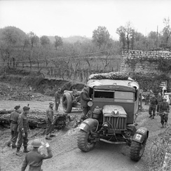 A Scammell Pioneer tows a howitzer of 18 Battery, 56th Heavy Regiment in Italy, 23 December 1943