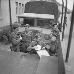 British and German officers finalize the arrangements for the ending of their temporary truce, April 1945
