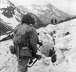 U.S. troops negotiate snow and ice during the battle on Attu in May 1943.