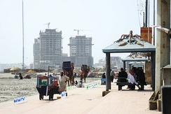 Clifton Beach in Karachi, with under-construction skyscrapers in the background.