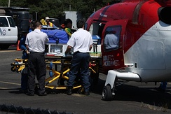 Patient being loaded into an medical helicopter